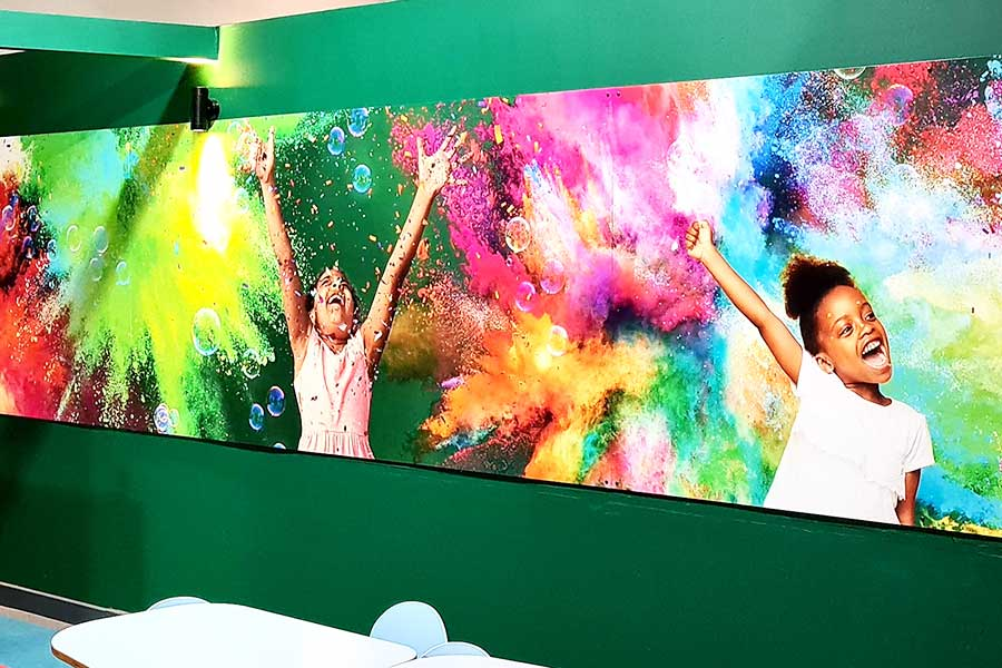 Full length digitally printed imagery created by Bluedot Display for the walls of the café at Kidspace in Romford